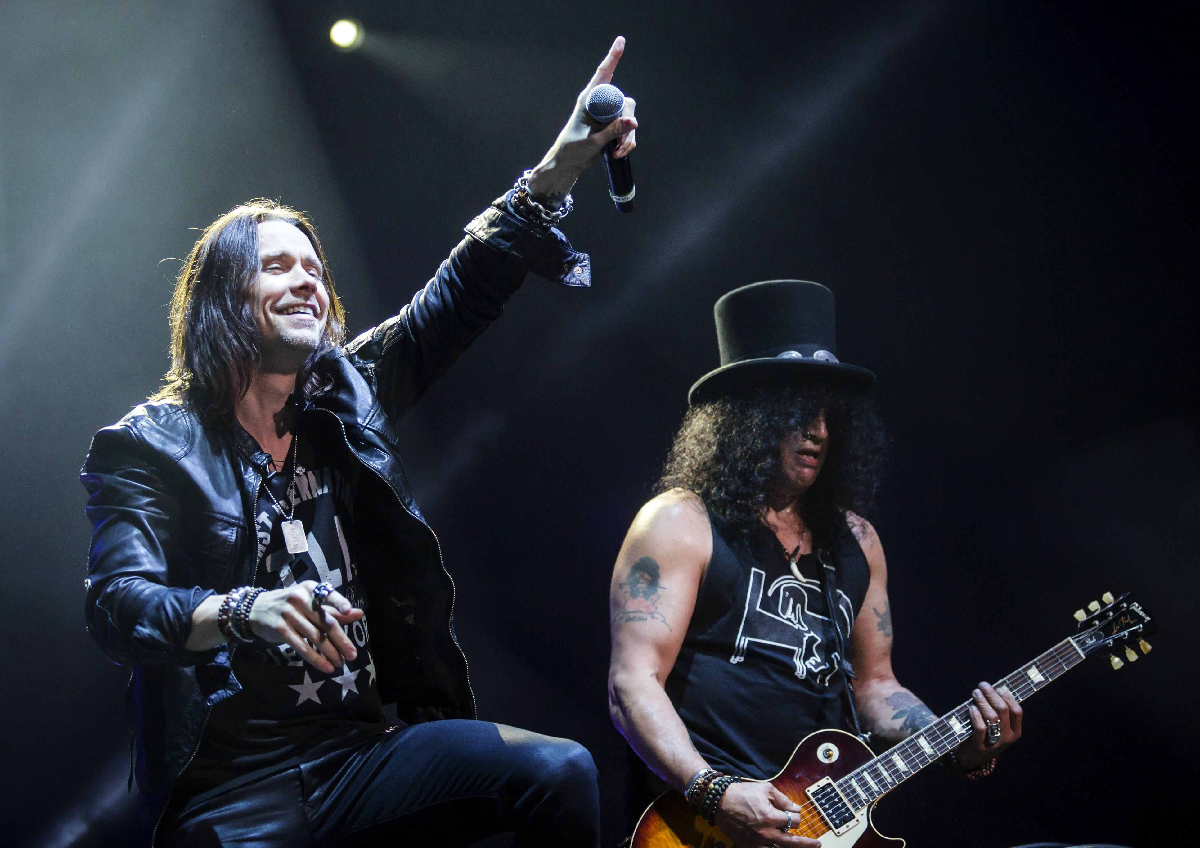 HUNGARY OUTMandatory Credit: Photo by Balazs Mohai/Epa/REX/Shutterstock (8307539c) A Photograph Made Avaiable on 19 November 2015 Showing Us Singer Myles Kennedy (l) and British - Us Guitarist Saul Hudson Aka Slash Performing During the Concert of Slash and Myles Kennedy & the Conspirators in Papp Laszlo Sports Arena in Budapest Hungary 18 November 2015 Hungary Budapest Hungary Music - Nov 2015