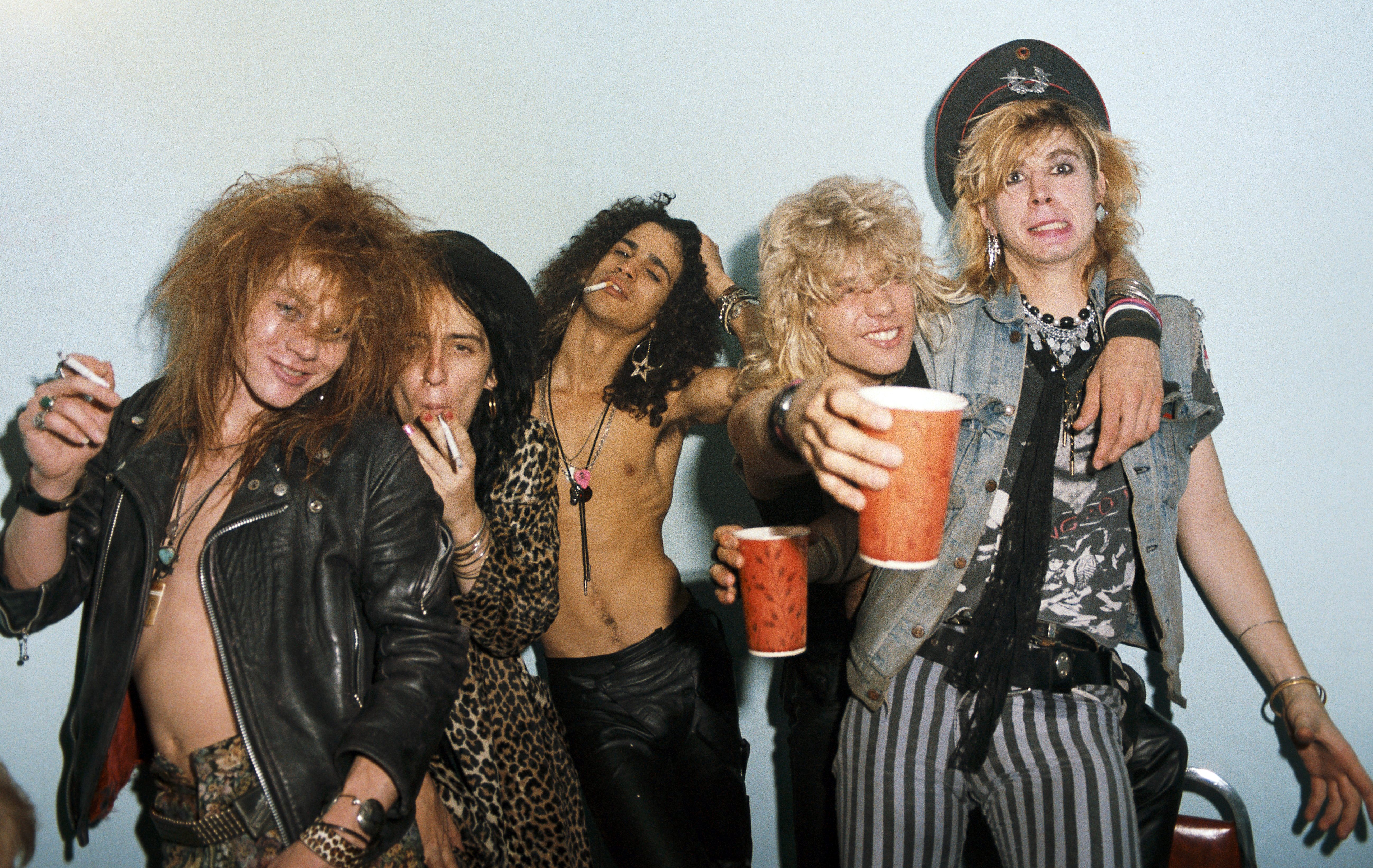 LOS ANGELES - JUNE 28: (L-R) Axl Rose, Izzy Stradlin, Slash, Steven Adler and Duff McKagan of the rock group 'Guns n' Roses' pose for a portrait at the Stardust Ballroom on June 28, 1985 in Los Angeles, California. (Photo by Jack Lue/Michael Ochs Archives/Getty Images)
